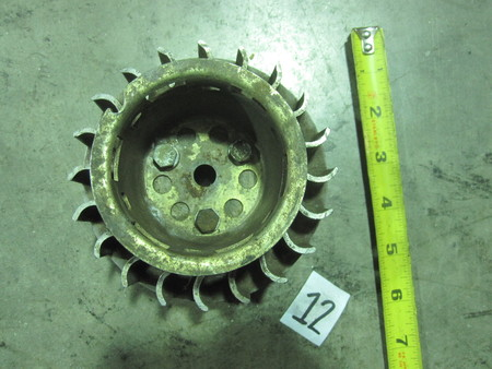 Flywheel for small engine (?)  : See photos.  None visible.