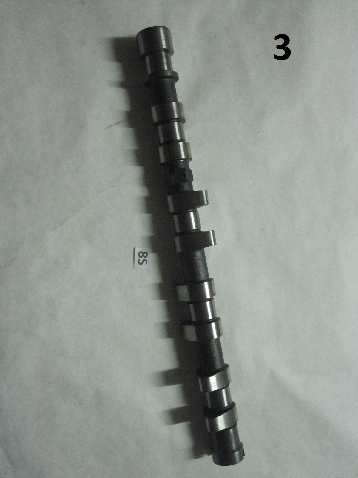 This is an aftermarket intake camshaft for a Mitsubishi