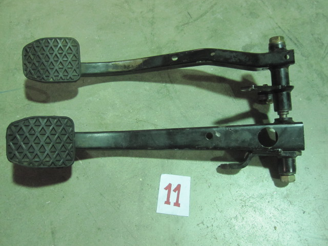 This is a clutch pedal/brake pedal assembly from a BMW E30 (1982